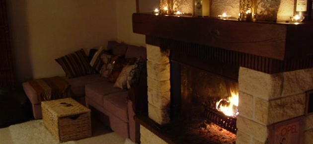 Cosy by the fire in the Normandy holiday cottage